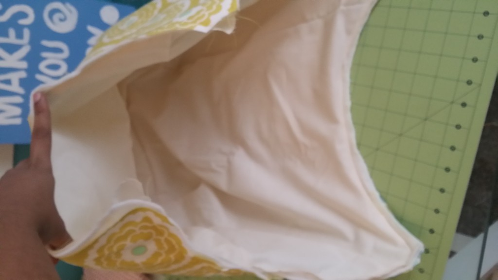 Fit lining into main bag wrong sides together and sew all around the top.