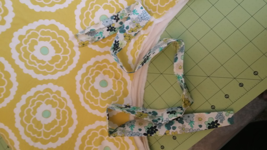 Sew on your binding all the way around doing the front first then the back.