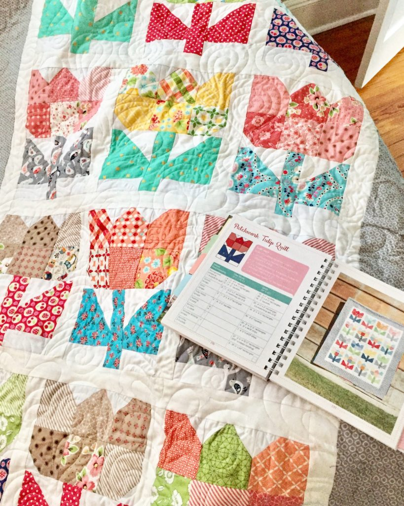 Patchwork Tulip Quilt and Planner on couch
